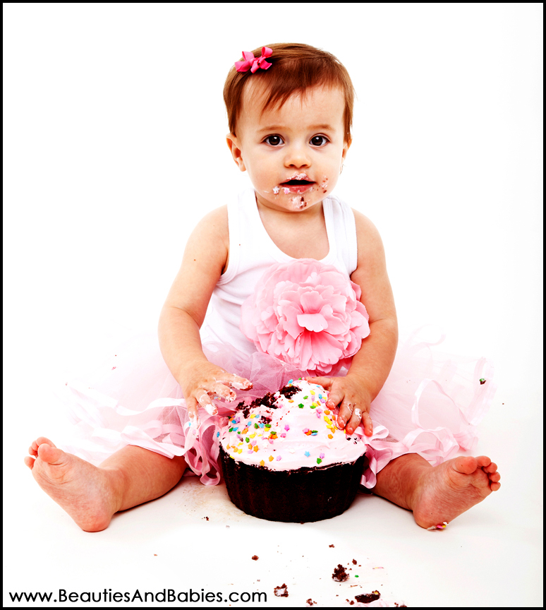 baby girl eating birthday cake professional studio baby portraits on images baby eating birthday cake