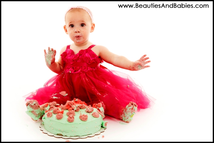 professional pictures baby eating birthday cake