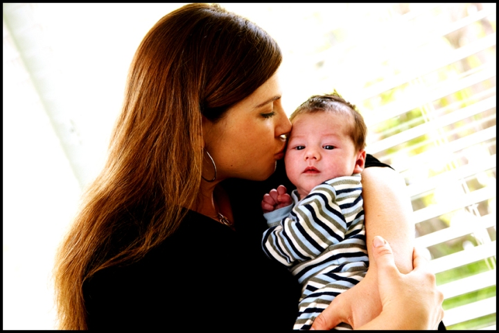 mother kissing child professional newborn pictures Los Angeles photographer