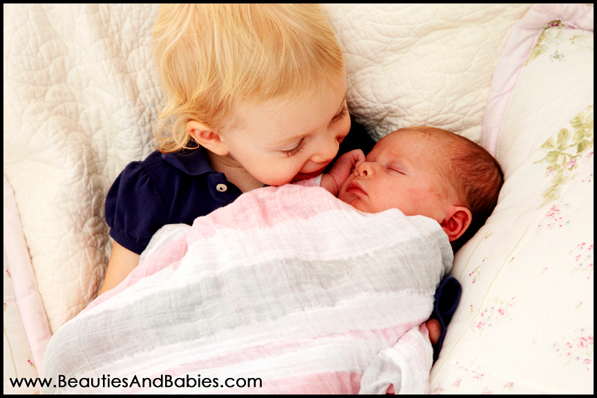 child holding newborn baby sibling Los Angeles photography