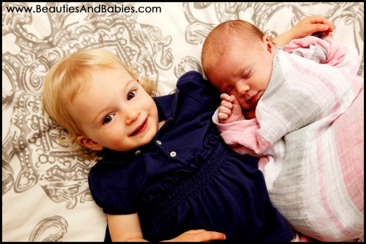 child holding newborn sibling professional pictures Los Angeles photography