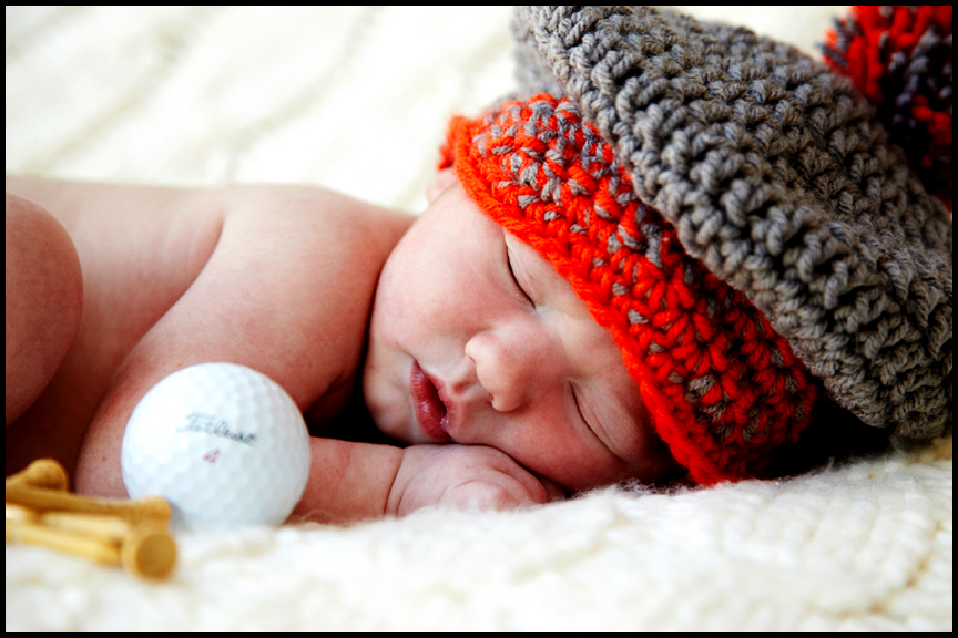 Newborn baby with golf props los angeles professional newborn baby photographer