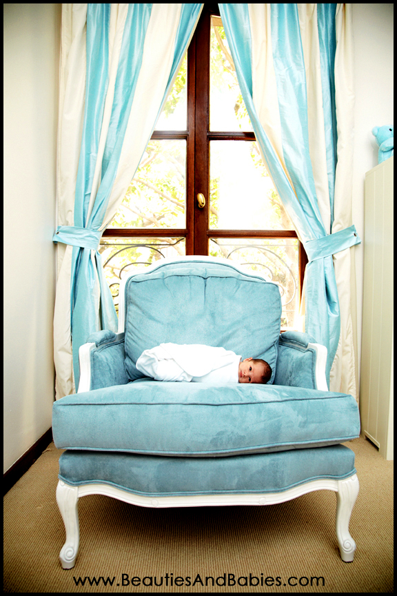 newborn baby laying on chair professional pictures Beverly Hills