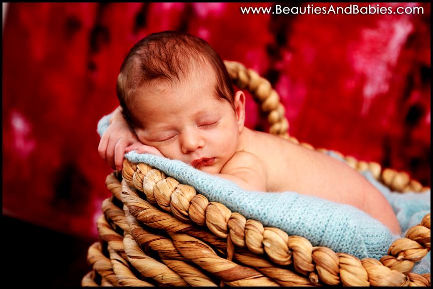 newborn baby in basket creative new born baby portraits Los Angeles