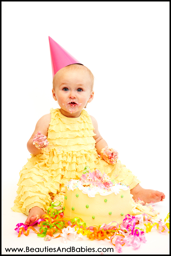 baby girl eating birthday cake Los Angeles professional photography