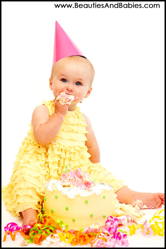 baby gitl eating cake first birthday professional pictures Los Angeles