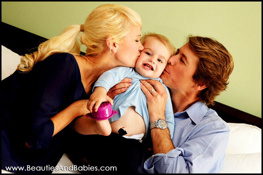 professional family pictures parents kissing child Los Angeles photography