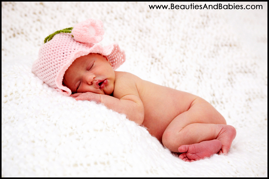 newborn baby sleeping on blanket professional at home photography
