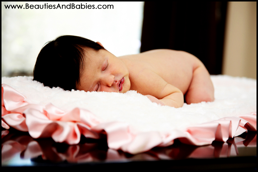 newborn baby sleeping on blanket professional baby pictures Los Angeles photographer