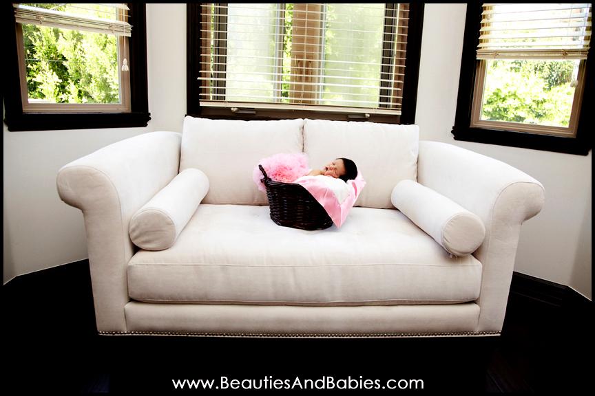 sleeping newborn baby girl in basket with tutu Los Angeles photographer