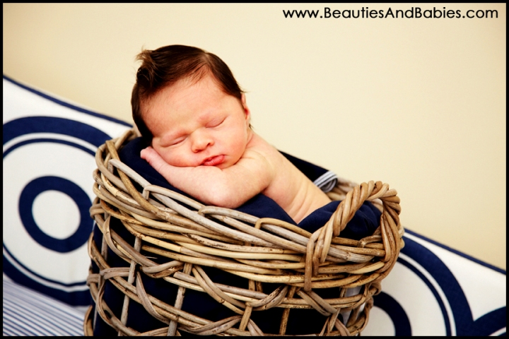 professional newborn baby sleeping in basket Los Angeles professional photographer