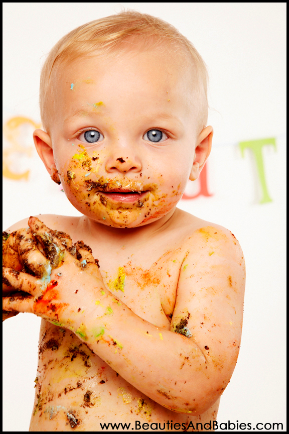 baby eating cake professional kids birthday photography