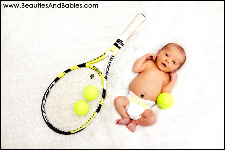 newborn baby and tennis racket creative newborn baby photography