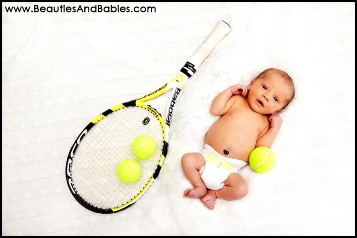 newborn baby and tennis racket creative newborn baby photography