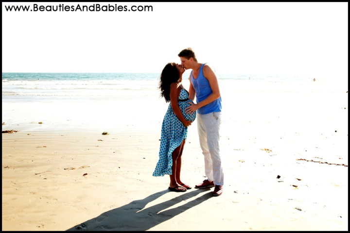 pregnant couple kissing on the beach professional photography Los Angeles