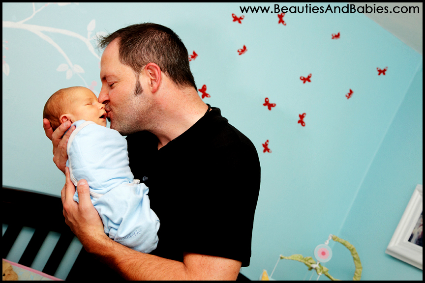 sleeping newborn baby and father professional pictures Los Angeles photographer