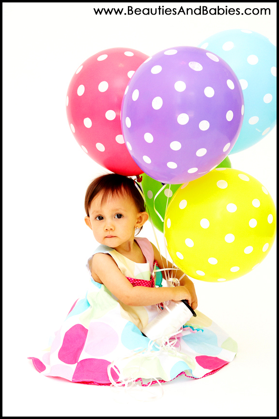 baby sitting with balloons professional child pictures Los Angeles photographer