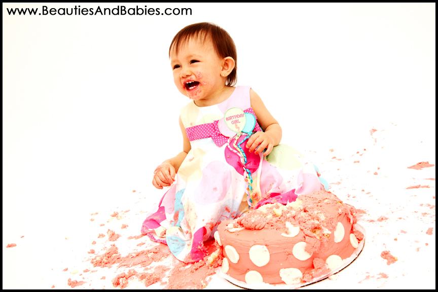 baby eating birthday cake professional cake smash photography studio Los Angeles