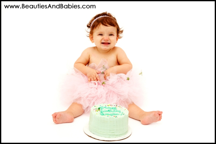baby eating birthday cake professional photographer