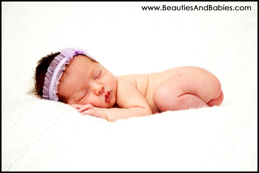 newborn baby girl sleeping on blanket Los Angeles professional photographer