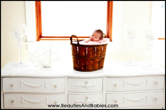 newborn baby sleeping in basket at home professional photography