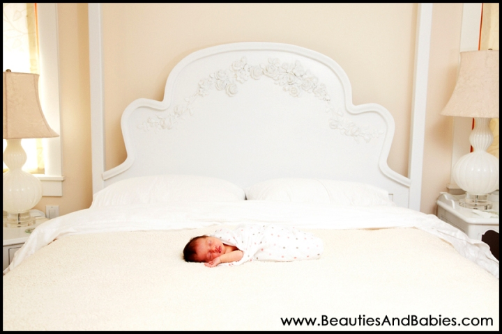 newborn baby sleeping on bed professional photography at home