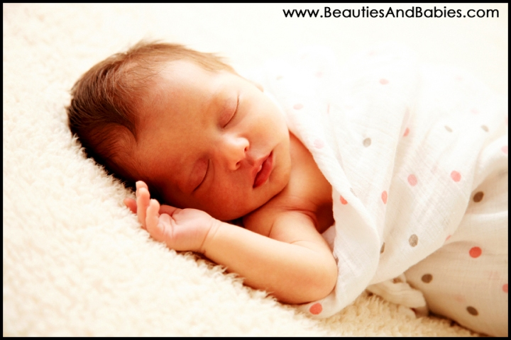 sleeping newborn baby girl professional photographer