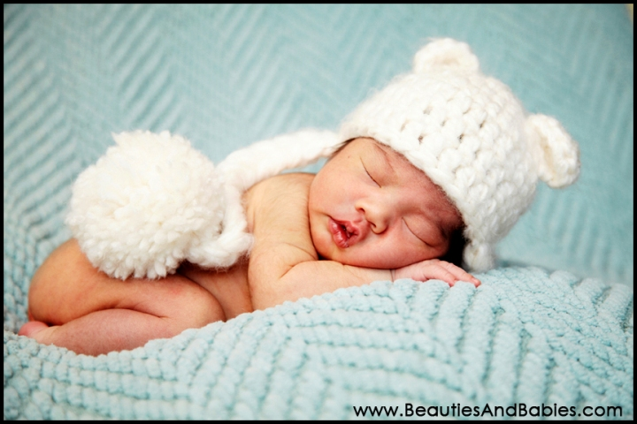 sleeping newborn baby in hat Los Angeles professional photography at home