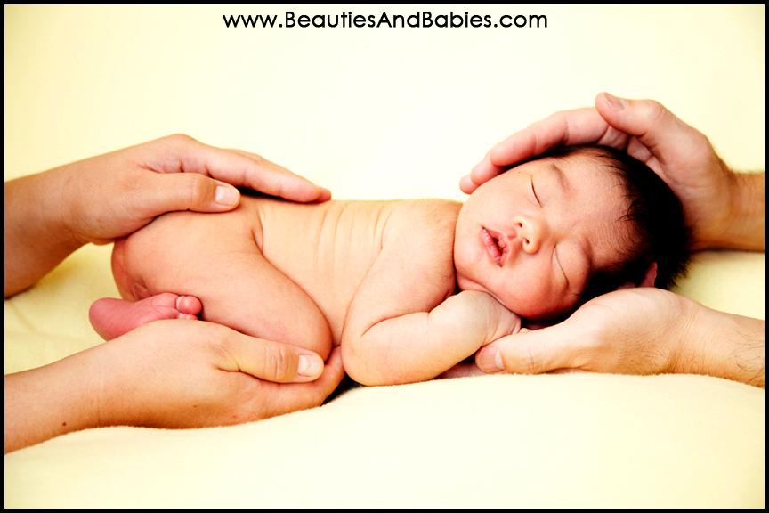 sleeping newborn baby boy in hands Los Angeles photographer