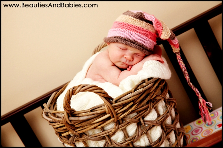 newborn baby girl sleeping in basket Los Angeles professional photography