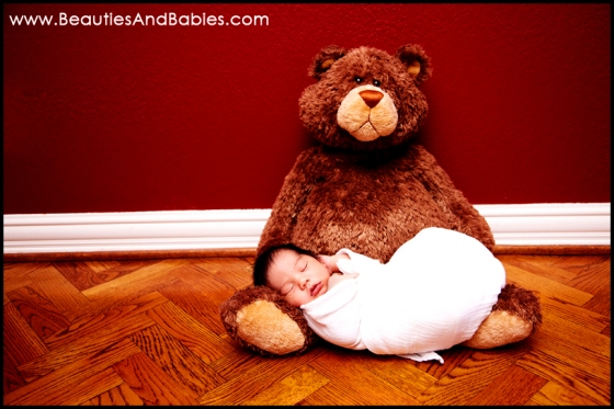 newborn baby sleeping on teddy bear professional photography Los Angeles