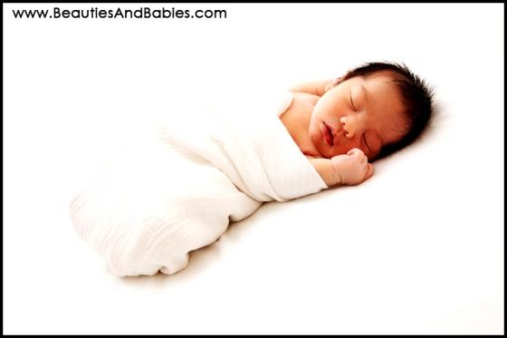 newborn baby boy sleeping in swaddle professional photographs Los Angeles photographer