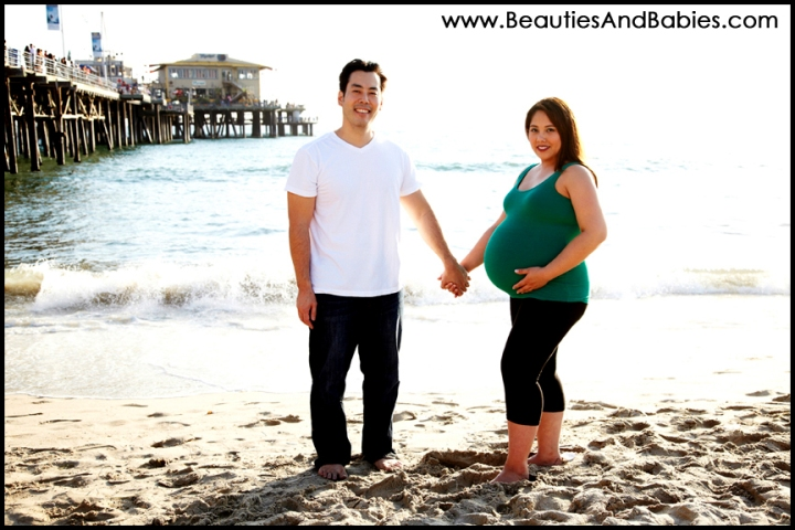 pregnant couple on the beach professional pictures Los Angeles